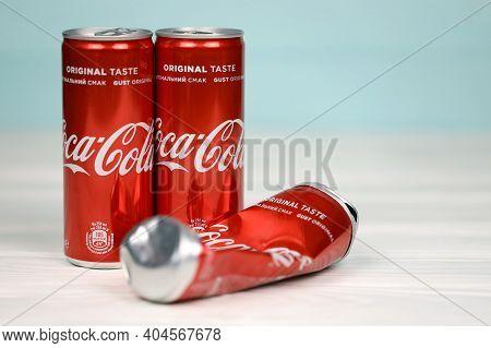 Kharkov, Ukraine - December 8, 2020: Coca Cola Aluminium Drink Cans On White Table. Coca-cola Or Cok