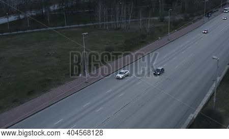 Aerial View Of Cars On Highway. Stock Footage. Multi Lane Motorways With Driving Vehicles Along Gree