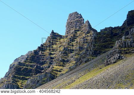 Beautiful Layer Of Rock Formations On Top Of The Mountains Near East Fjords, Iceland During The Summ