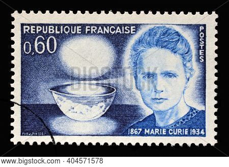 ZAGREB, CROATIA - AUGUST 28, 2014: Stamp printed in the France shows Marie Sklodowska Curie (1867-1934), bowl glowing with radium, physicist and chemist, 1967