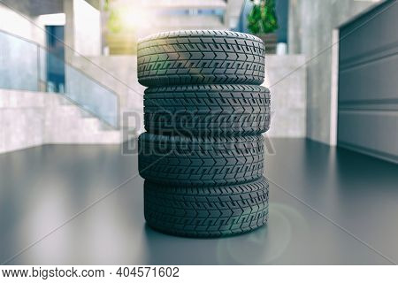 Four tires stacked on top of each other. Good graphics for a tire store, storage room, tire service. 3d illustration on white.