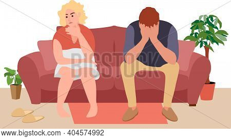 A Young Couple Sits Of The Couch And Quarrels. People Spend Time At Home. The Psychological Concept