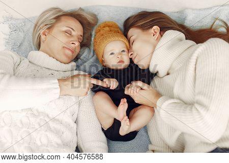 Elegant Grandma At Home With Daughter And Grandson
