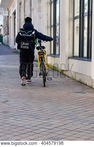 Bordeaux , Aquitaine  France - 01 18 2021 : Uber Eats Man Biker Delivery Boy With Large Back Pack Lo