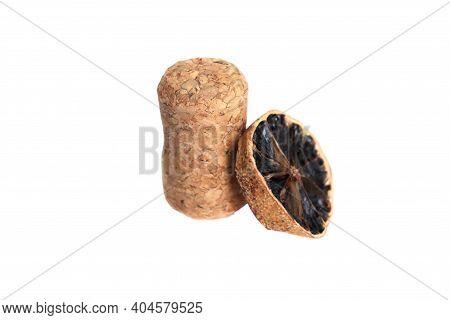 Cork On A White Background. Cork And Fruit Slice. Cork Isolate. Dried Orange Slice. Champagne Cork
