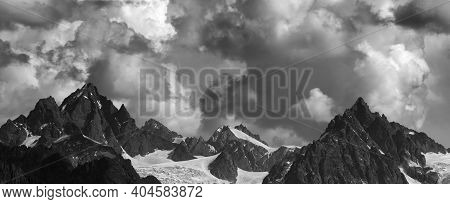 Panoramic View On High Mountains With Glacier And Cloudy Sky At Summer Day. Caucasus Mountains, Geor