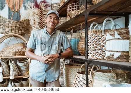 Handicraft Business Owner With His Hands Leaning Back On A Shelf While In A Handicraft Shop