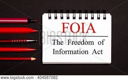 A White Notepad With The Text Foia The Freedom Of Information Act, Written On A White Notepad Next T