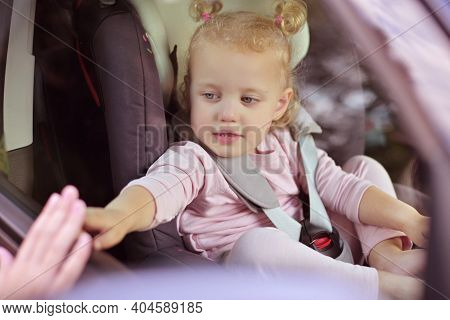 Touching Moment Of Mothers Farewell To Child. The Child Sits In The Car And Puts His Hand To The Gla