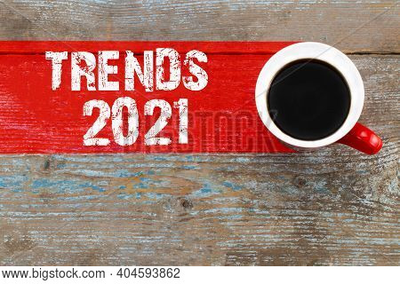 Trends 2021 / Cup Of Coffee With Trends Inscription On Wooden Background
