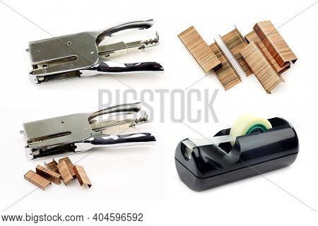 Vintage metal stapler with some staples and a tape dispenser on a white background