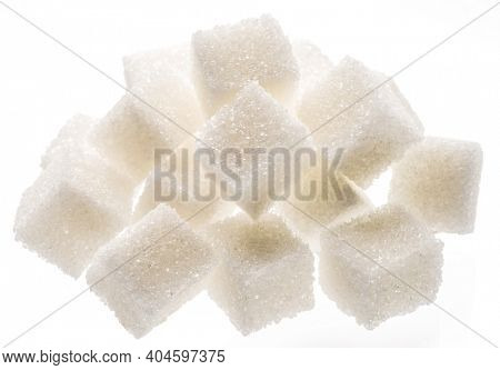 White sugar cubes on white background. Macro picture.