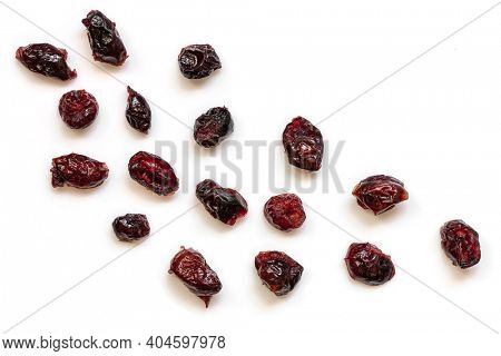 Dried cranberries isolated on white.  Top view, scattered.