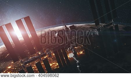 International Space Station closeup: solar panels elements on technology admist Earth mainland background illuminated at night. Spatial planets exploration in 3d animation. Product furnished by NASA