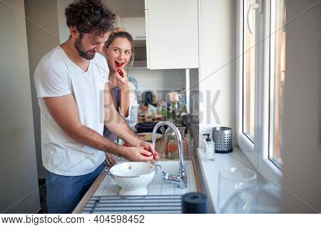 Boyfriend making surprise breakfast for his girlfriend on Valentine's day