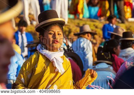 PUNO, PERU - CIRCA AUGUST 2018: Authentic Colorful Carnival on the streets in Puno, Peru. One of the late summer fests on the shores of the high altutude Titicaca lake.