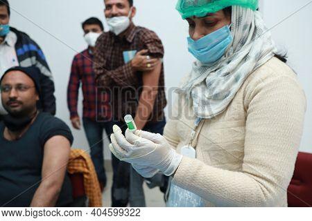 January 16 2021, Kishanganj, Bihar, India. A Nursing Staff Drawing Covishield Vaccine In A Syringe P