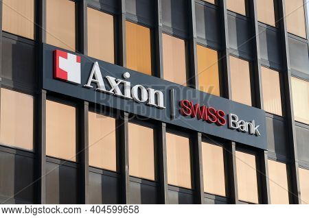 Lugano, Switzerland - 12th January 2021 : Axion Swiss Bank Sign Hanging On The Headquarters In Lugan
