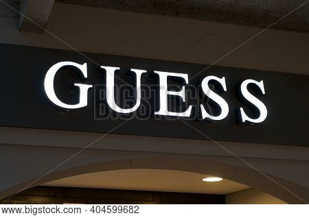 Lugano, Ticino, Switzerland - 14th January 2021 : Luminous Guess Store Sign Hanging On The Shop Entr