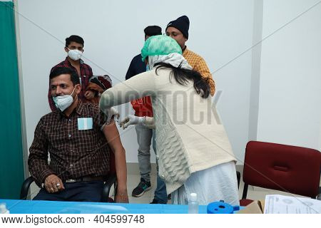 January 16 2021, Kishanganj, Bihar, India. A Doctor Wearing A Mask Undergoing Covishield Vaccination