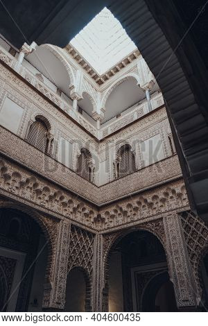 Seville, Spain - January 19, 2020: Low Angle View Of Ornate Dolls Courtyard Of the Mudejar Palace