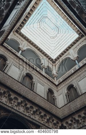 Seville, Spain - January 19, 2020: Low Angle View Of Skylight In Dolls Courtyard Of the Mudejar Pa