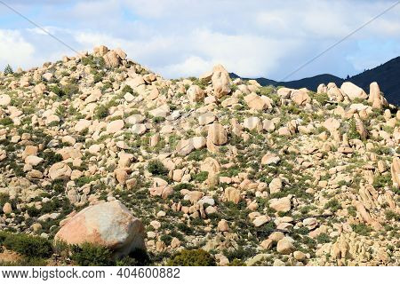Large Rocks And Boulders On An Arid Hillside Taken On Rural Badlands At The Mojave Desert In The Sou