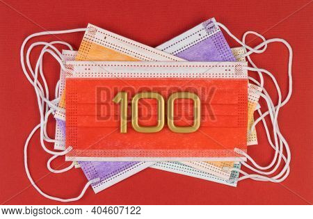 Number 100 On Medical Disposable Masks. Color Surgical Mask. Compliance With The Regime Of Permanent
