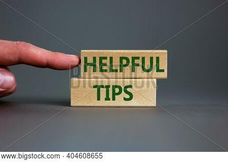 Helpful Tips Symbol. Wooden Blocks With Words 'helpful Tips'. Beautiful Grey Background. Businessman