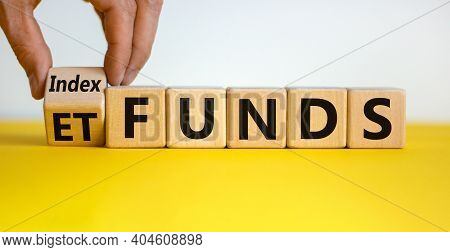 Index Funds Vs Etf Symbol. Businessman Turns A Cube And Changes Words 'etf' To 'index Funds. Beautif