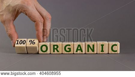 100 Percent Organic Symbol. Businessman Turns Wooden Cubes And Changes Words 'organic' To '100 Perce