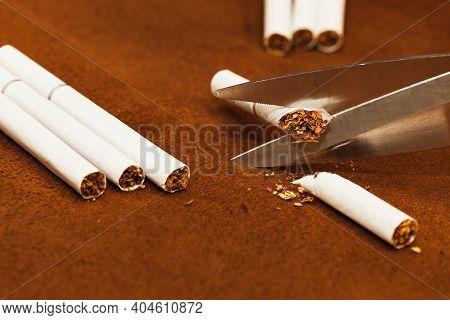 Anti-smoking Concept, Close Up Of Scissors Cutting Cigarette.