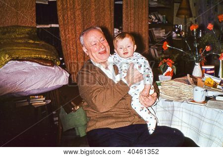 Vintage photo of great grandfather with his baby great granddaughter (early seventies)