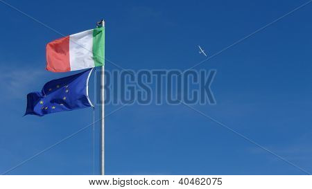 italy and europe flags on blue sky