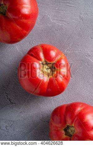 Three Pink Heirloom Tomato Vegetables In Row, Fresh Red Ripe Tomatoes, Vegan Food, Stone Concrete Ba