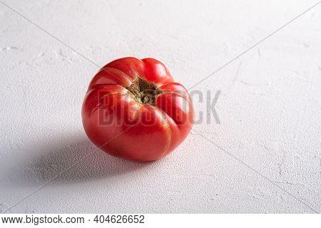 One Pink Heirloom Tomato Vegetable, Fresh Red Ripe Tomatoes, Vegan Food, White Stone Concrete Backgr