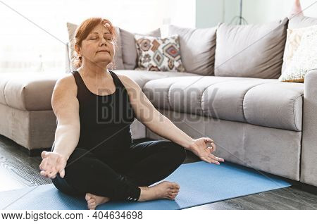 Middle Aged Woman In Yoga Position Keeps Fit In Her Home - Elderly Person Has Fun Doing Sports - Men