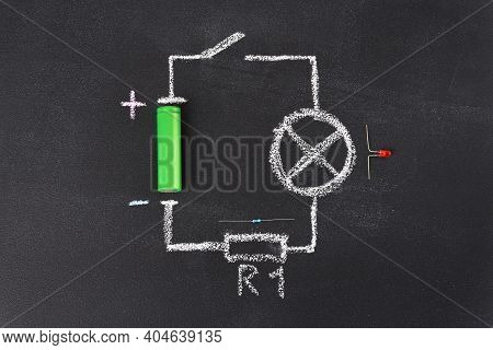 The Simplest Circuit Is Drawn In Chalk On The School Blackboard.