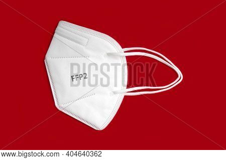 Side View Of Ffp 2 N95 Protective Face Mask Isolated On Red Background.