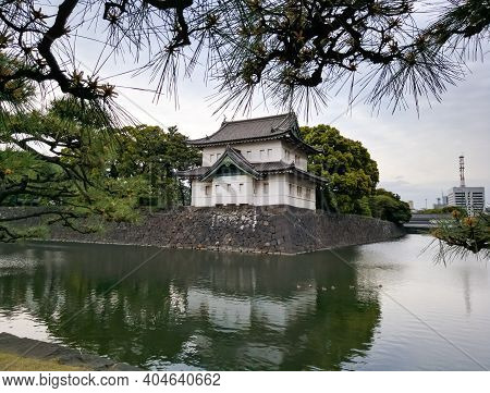 Tokyo, Japan - April 3, 2018: View Of The Temple And The Pond From The Square Of The Imperial Palace
