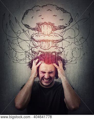 Head Explosion Metaphor. Bewildered Man Messing Up And Pulling His Hair,  Eyes Closed Screaming And