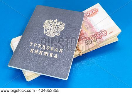Labor Book And Russian Money On The Table. Payments Under An Employment Contract / Translation Into