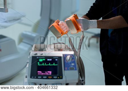 The Doctor Is Giving A Defibrillators To Save The Patient\'s Life In The Hospital.