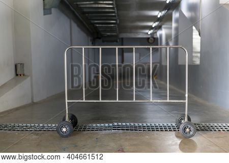 Metallic Barrier For Security In Front Of The Entry Way. Steel Barrier On Wheel On Car Park. Balustr