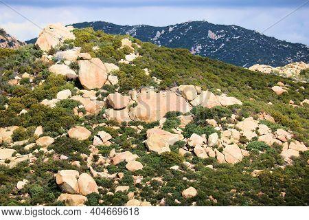 Arid Hillside Covered With Large Boulders Besides Chaparral Plants Taken On Rural Badlands At The Mo