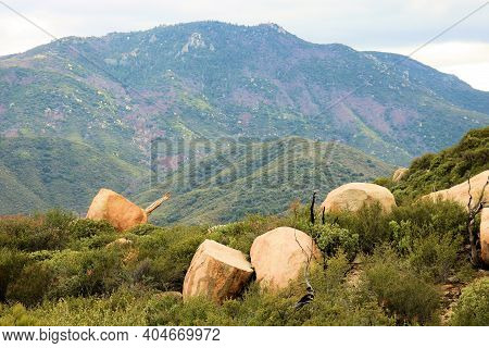 Rural Mountainous Terrain Covered With Chaparral Shrubs And Boulders Taken At An Arid Field In The A