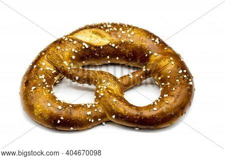 Bavarian Pretzel With Salt Isolated On White Background