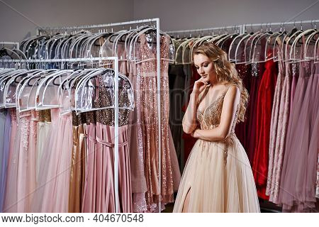 Young Beautiful Blonde Girl Wearing A Full-length Beige Yellow Champaign Chiffon Slit Prom Ball Gown