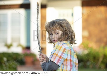 Negative Child Emotion. Kids Aggression. Angry Boy With Stick. Kid Adaptation. Bully. Bullying Conce