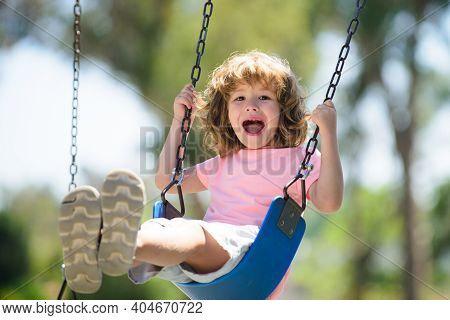 Child Swing On Backyard. Kid Playing Oudoor. Happy Cute Little Boy Swinging And Having Fun Healthy S